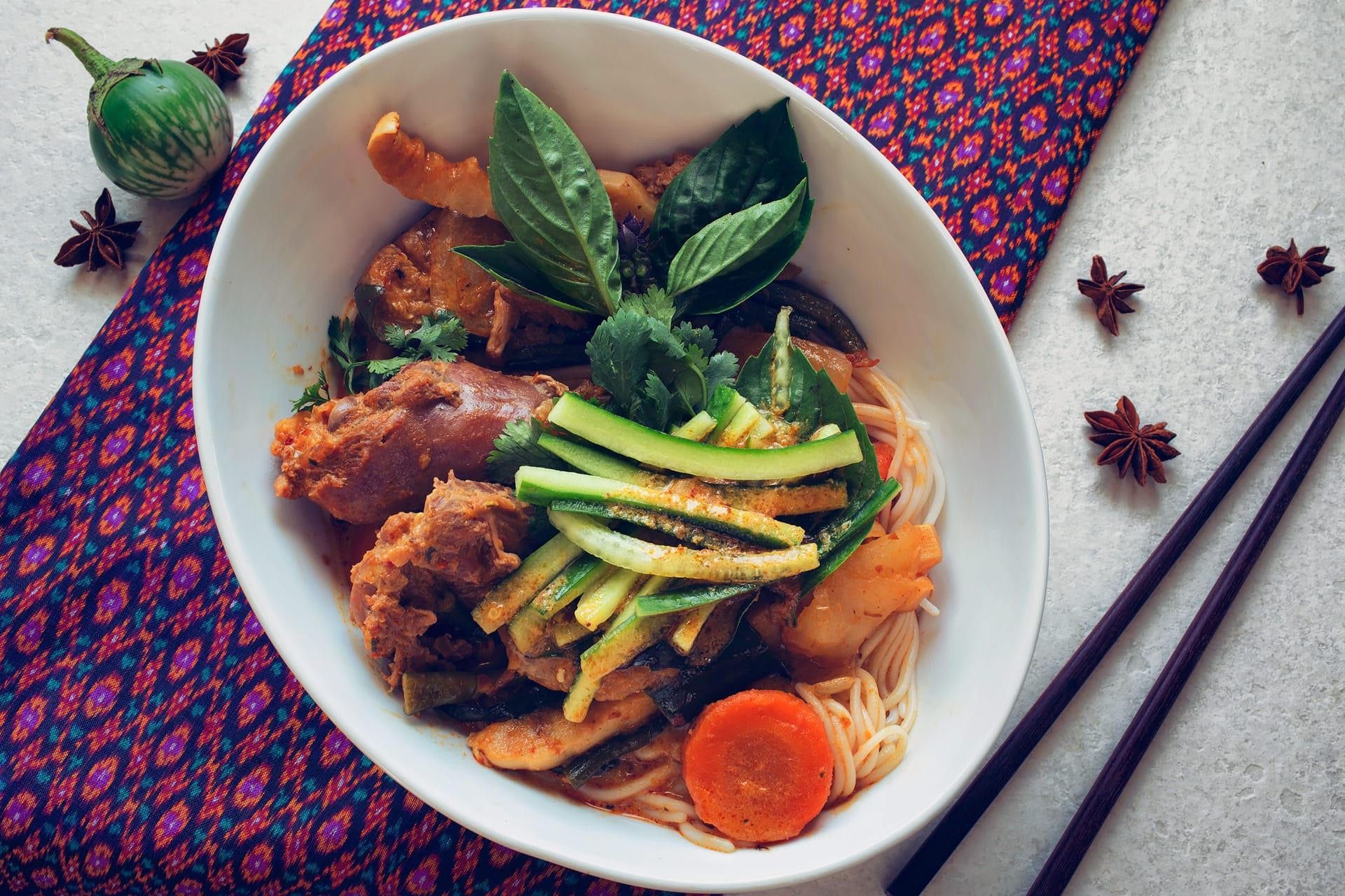 Cambodian chicken curry recipe with noodle topped with fresh cucumbers