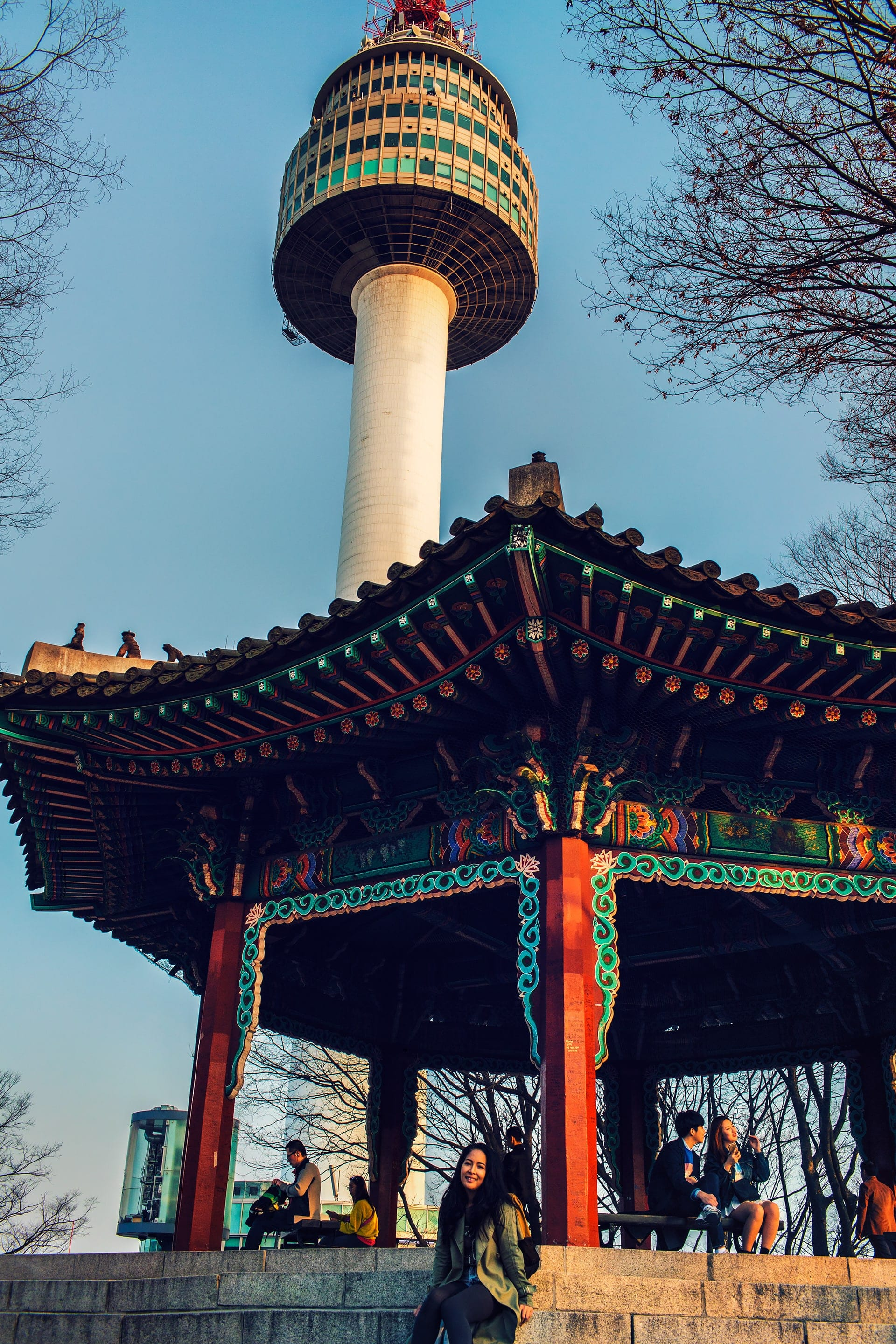People relaxing under the pavilion in front of N Seoul Tower at Namsan Park in Seoul South Korea