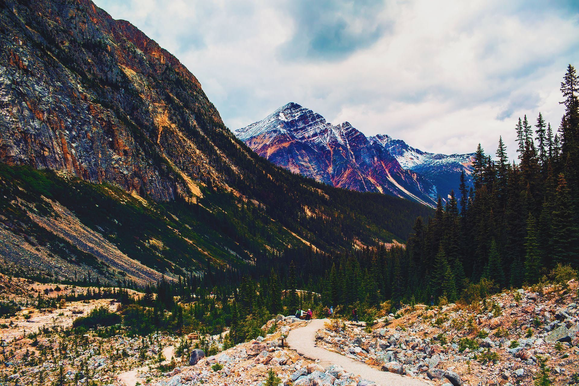 View of the rocky and glacier capped mountains at Mount Edith Cavell Hike in Alberta Canada