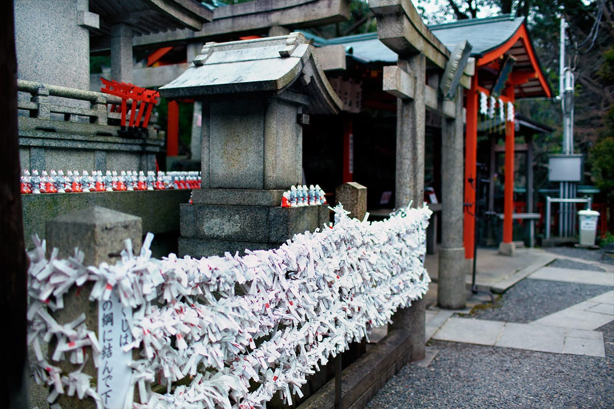 Paper Omikuji Wishes at Fushimi Inari Taisha Shrine in Kyoto Japan