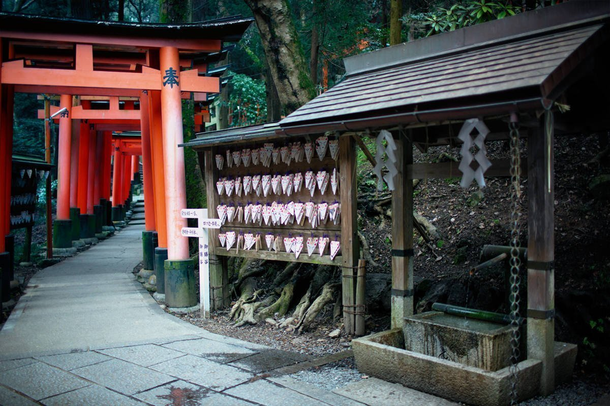 Torii gates and Inari fox wish plates at fushimi inari taisha shrine