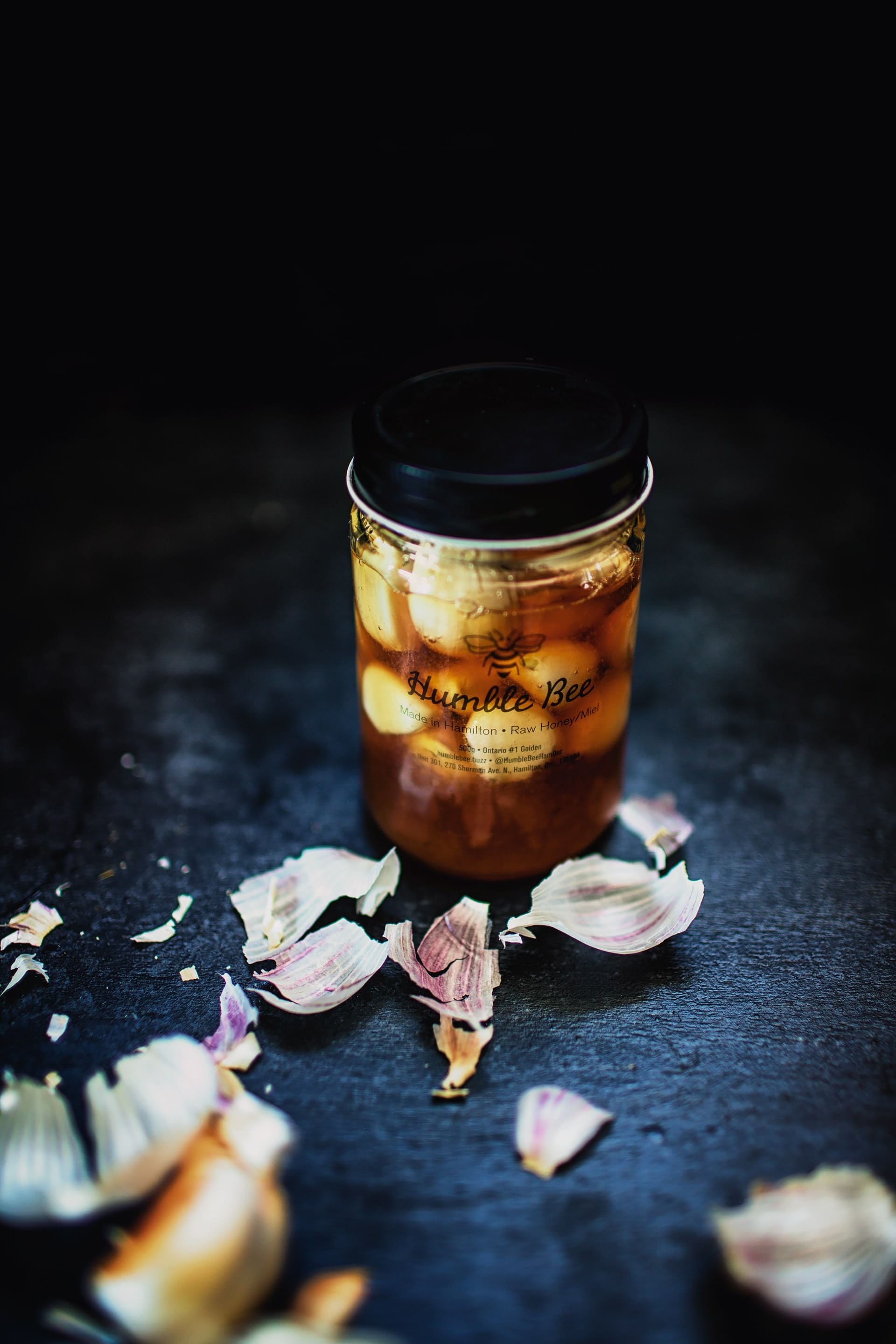 garlic and honey ferment in a glass jar for cold and flu season